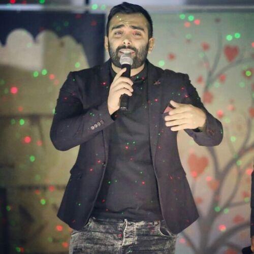 دانلود آهنگ جدید مسعود صادقلو به نام رنگ چشمات عجیبن